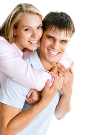 smiling young man: Portrait of a beautiful young happy smiling couple - isolated