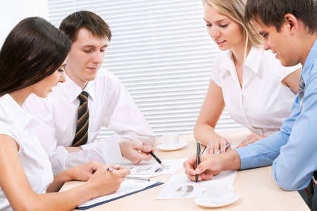 Happy business people in an  modern office Stock Photo - 12836540