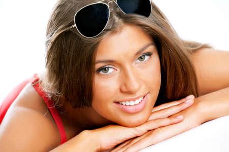 young girls breast: Beautiful brunette woman in bikini and sunglasses
