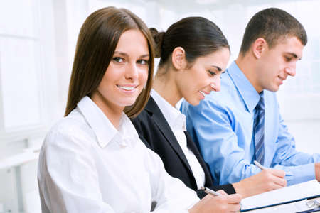 businessmeeting: Young business woman with colleagues