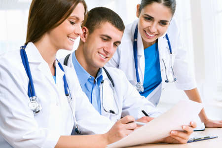 medical history: Young doctors discuss medical history Stock Photo