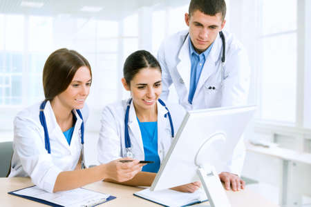 ward: Young doctors discuss medical history Stock Photo