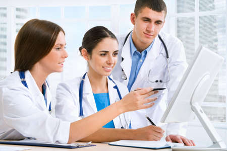 Medical team working in hospital photo