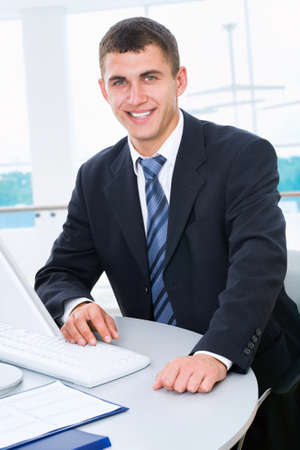 Young businessman working in office photo