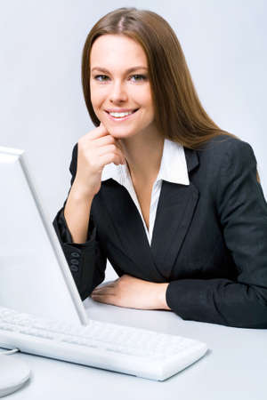 bile: Business woman at the office with a computer Stock Photo