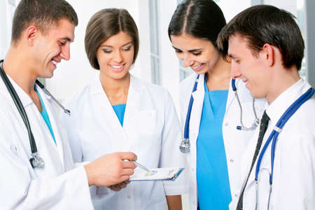 consultant physicians: Young doctors working in hospital Stock Photo