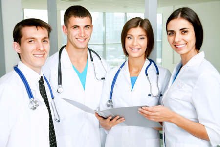 doctors smiling: Young doctors looking at camera Stock Photo