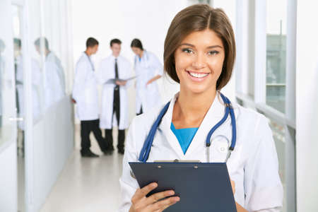 Young female doctor and her colleagues Stock Photo - 12836638