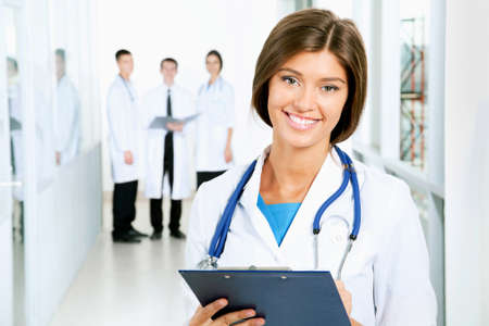 modern doctor: A young female doctor looking at camera Stock Photo
