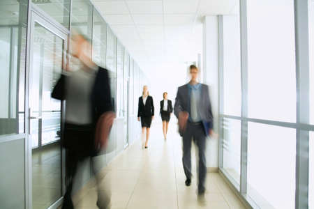corporation: Business people in modern office Stock Photo