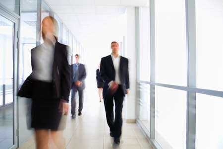 Business people walking in the office corridor Stock Photo - 12836534