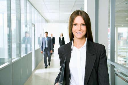 female boss: Nice business woman walking down the corridor office Stock Photo
