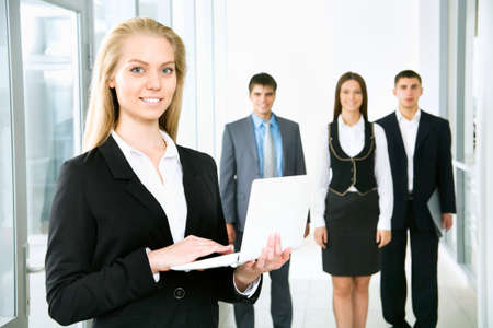 Young businesswoman and her colleagues photo