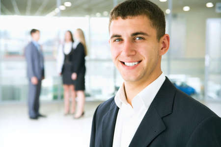 team leader: Young businessman in modern office