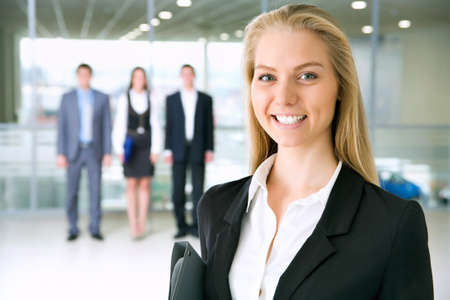 Young business woman and her colleagues Stock Photo - 12836675