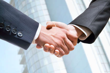 firm: Handshake business concept