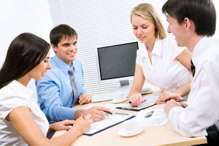 Image of business people discussing plan at meeting photo