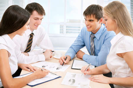 training consultant: Business team working on their business project together at office