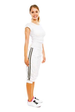 sports wear: Young happy woman in sports wear   Stock Photo