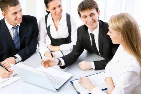 modern businesswoman: Business meeting in an office with businessmen and businesswomen Stock Photo