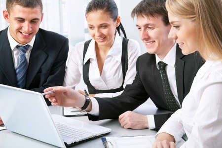 Photo of business people looking at laptop monitor  Stock Photo