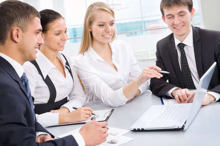 leadership training: Business meeting in an office with businessmen and businesswomen Stock Photo