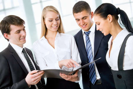 young executives: Group of business people working at office