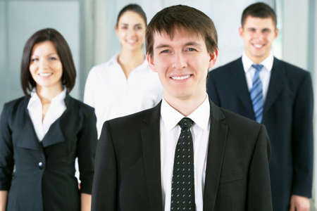 Portrait of a businessman and her colleagues at the background Stock Photo - 13462020