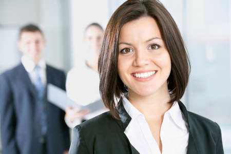 Portrait of a business woman and her colleagues at the background Stock Photo - 13541781