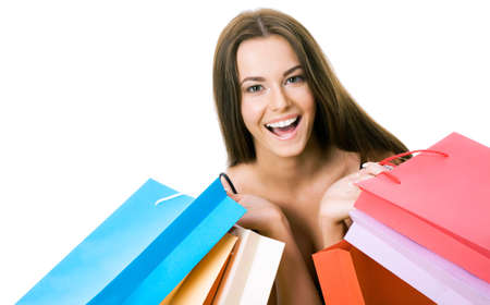 Portrait of a beautiful woman with colored shopping bags isolated on white  photo