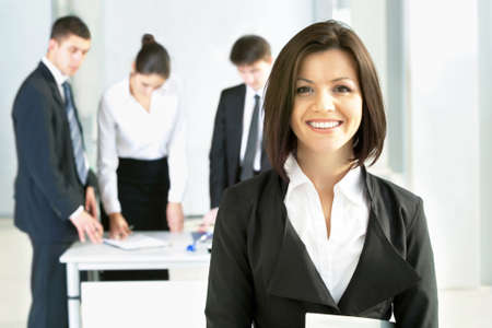 go inside: Young business woman with her colleagues Stock Photo