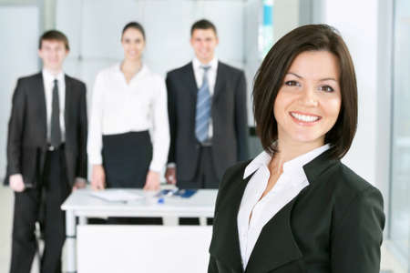 Young business woman with her colleagues photo