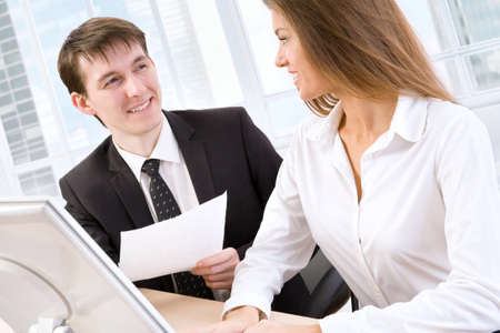 Business man showing something on monitor to his colleague Stock Photo - 13541706