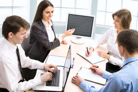 staff meeting: Smiling business people  in board room - Staff meeting   Stock Photo
