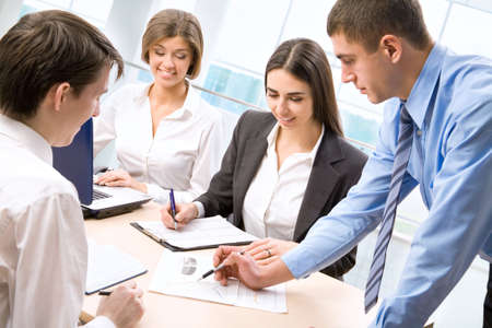 Group of business people analyzing and discussing during a working meeting in a modern office   Stock Photo - 13541782