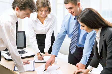 Group of happy business people in a meeting at office Stock Photo - 13541817