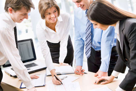 Business people analyzing and discussing during a working meeting in a modern office