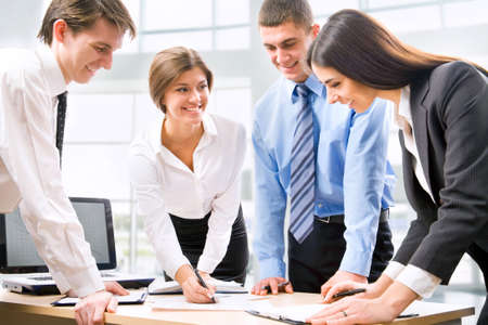 manager team: Group of business people discussing a new project in the office