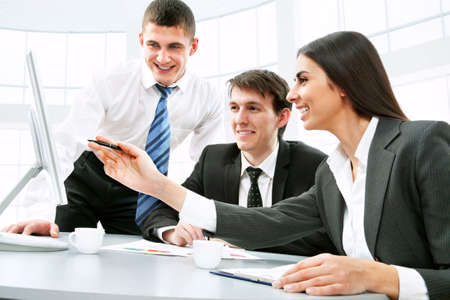 young office workers: Smiling business people  in board room