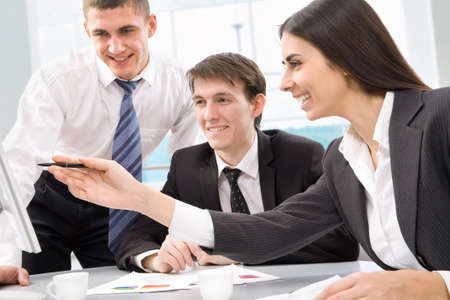 Boardroom meeting: Group of happy business people in a meeting at office