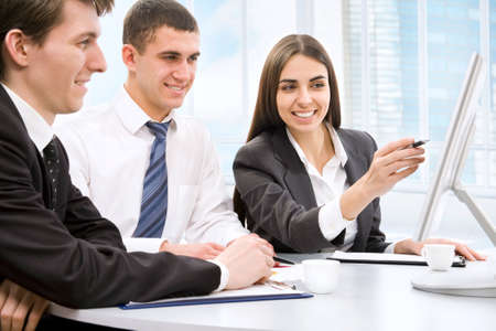 Group of happy business people in a meeting at office Stock Photo - 13541711