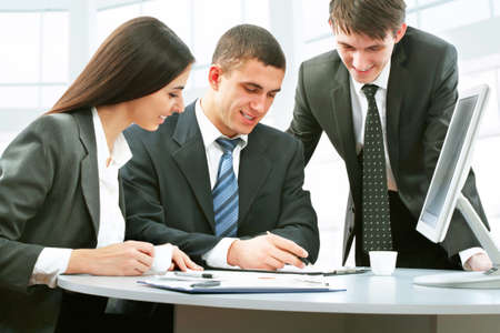 Group of happy business people in a meeting at office Stock Photo - 13541770