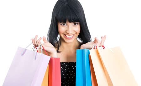 Portrait of a beautiful asian woman with colored shopping bags isolated on white Stock Photo - 13541494