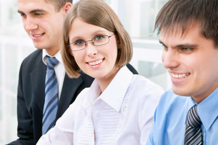 Young business woman with her colleagues Stock Photo - 13541735