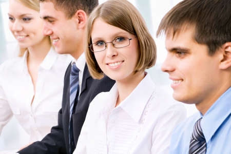 Image of a young business woman and her colleagues in the office Stock Photo - 13541608