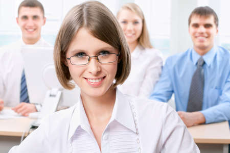 financial planner: Young business woman lawyer and her colleagues in the background