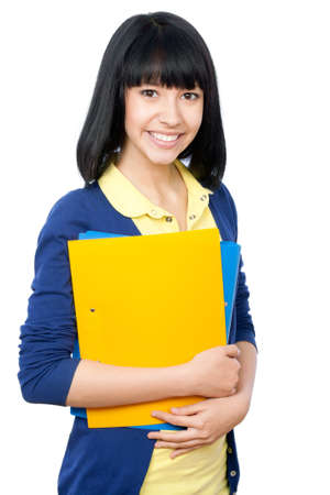 Cheerful girl student on a white background photo