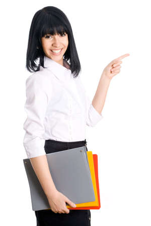 heed: Young business woman smiling and pointing to white background Stock Photo