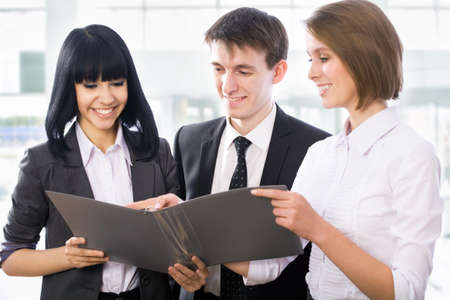 Happy young business people working together Stock Photo - 13622879