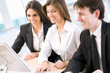 desk work: Young business people are working in the meeting room. Stock Photo